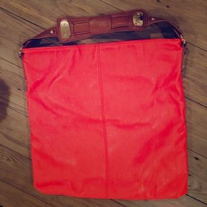 Large tangerine colored Express purse
